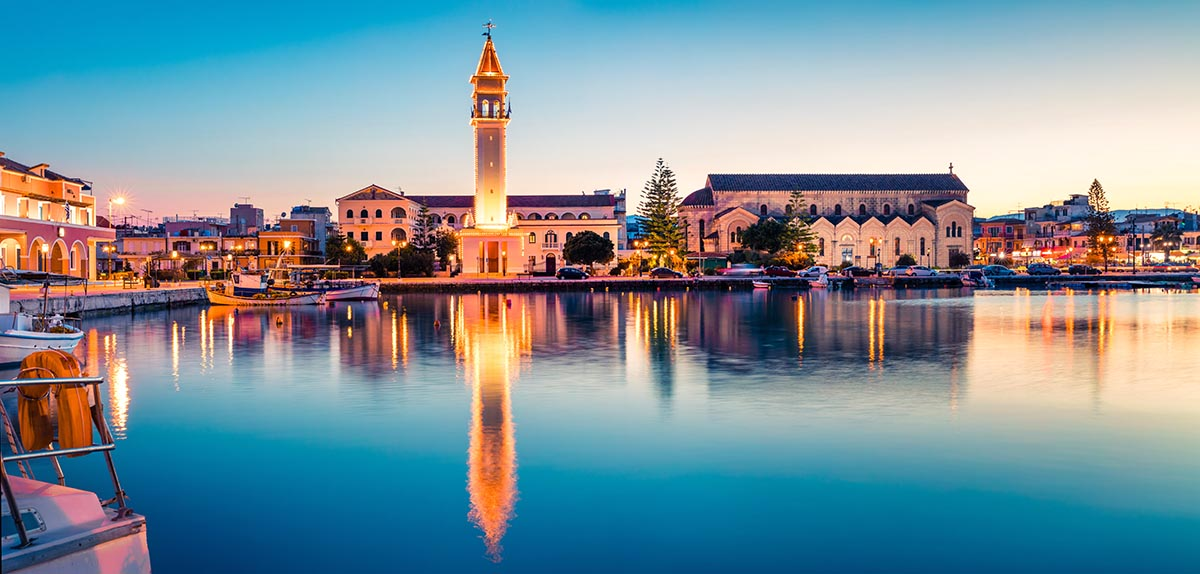 Great evening view of the town hall and Saint Dionysios Church