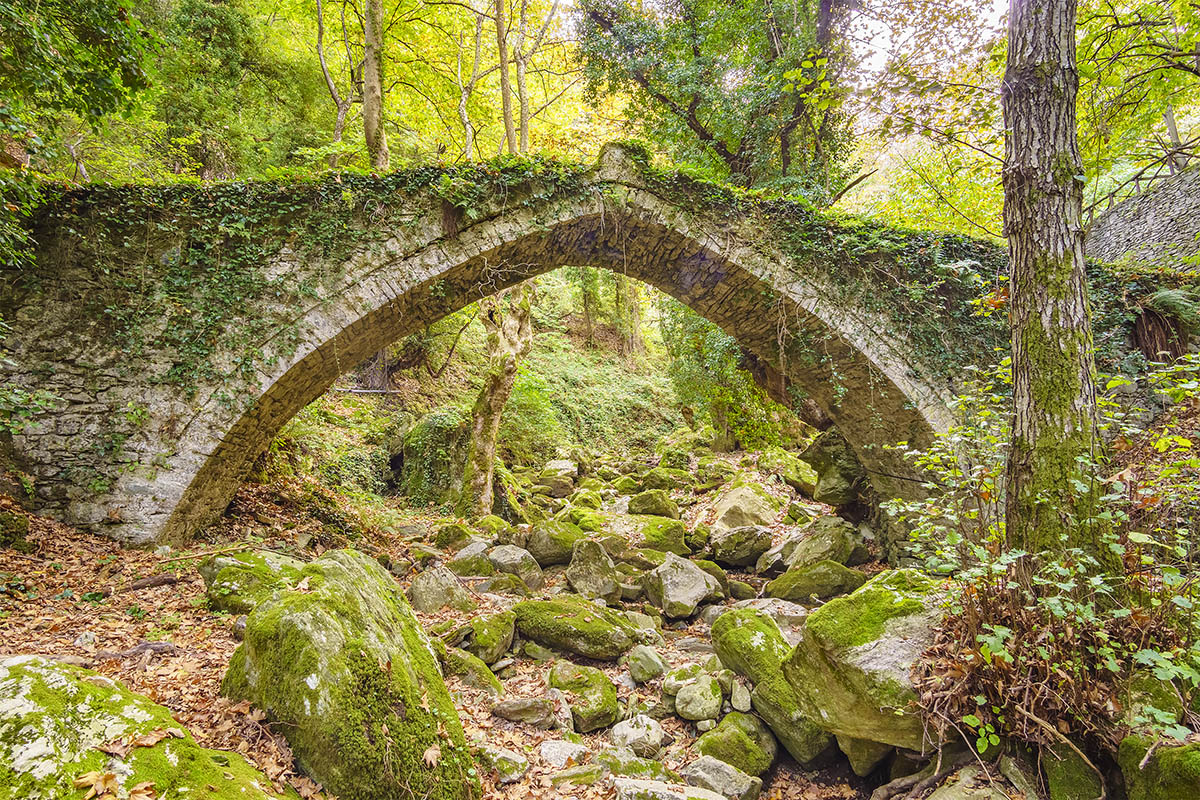 Old arched stoned bridge in Tsagarada and one of the most beautiful sightseeing of Pelion mountain. Magnesia - Greece